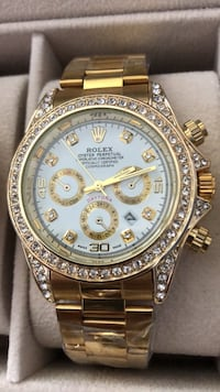 round gold-colored Rolex chronograph watch with clear gemstones and lnks Brampton, L6T 4A2