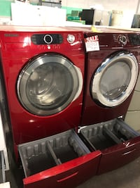 Samsung front load washer and dryer set with pedestal  Baltimore, 21223