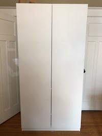 """IKEA White wooden 2-door wardrobe in perfect condition. A new one costs $199 with one less shelve. Width: 39 1/4 """" Frame, width: 39 3/8 """" Depth: 22 7/8 """" Height: 93 1/8 """" Frame, depth: 22 7/8 """" Frame, height: 92 7/8 """"   Width: 99.8 cm Frame, width: 100 cm Hamilton, L8P 3H3"""