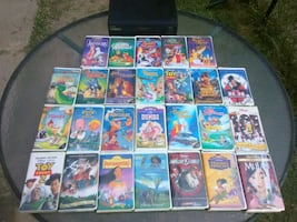 26 Classic Disney VHS tapes and Vhs player