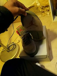 pair of black-and-gray Nike basketball shoes