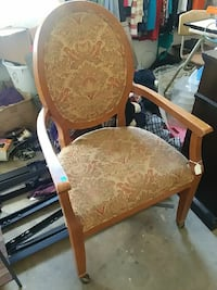 brown wooden framed beige floral padded armchair Jefferson City, 65109