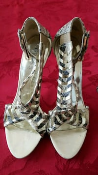 pair of gray-and-white striped Guess open-toe heel