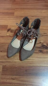 Pair of gray suede pointed-toe flat booties