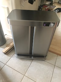 Stainless steel and black trash bin