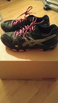 pair of black-and-pink Asics Gel running shoes 1173 km