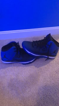 pair of black-and-blue Nike running shoes Bristow, 20136