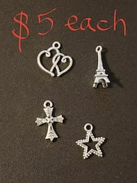 four assorted silver pendants Abilene, 79602