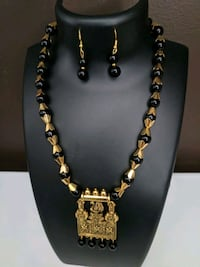 Black beads and gold necklace with earings