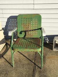 Old fashioned Green metal armchair