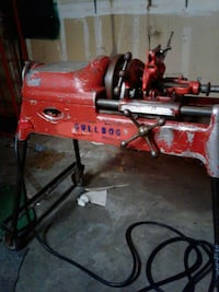 red and black Milwaukee corded power tool