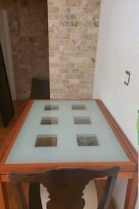 A Italian Teak wood table that is 48 inches long