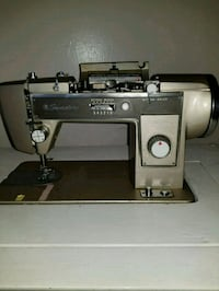 gray and black electric sewing machine 955 mi
