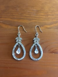 pair of silver-colored earrings London