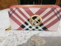 pink, red, and black plaid Michael Kors leather wr