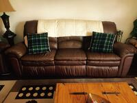 Brown leather 3-seat sofa with two green plaid throw pillows Dollard-des-Ormeaux, H9H 2A4