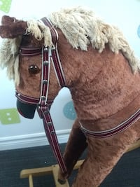 Wooden and straw made rocking horse