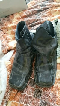 pair of black leather boots Montreal, H3R 3L4