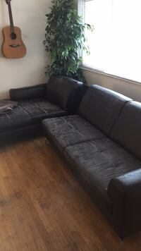 black leather sectional couch with throw pillows Seattle, 98102