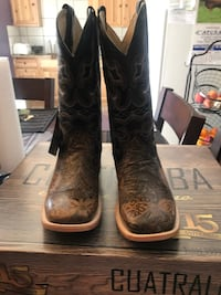 pair of brown leather cowboy boots Denver, 80239