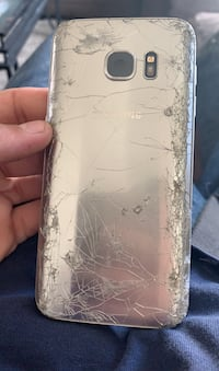 found in middle of street phone turns on but screen doesn't Anchorage, 99504