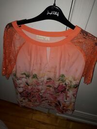 women's orange and red floral blouse