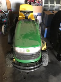 Green and yellow john deere ride on lawn mower Hagerstown, 21740