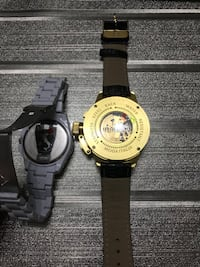 round gold-colored digital watch with black strap Laval, H7N 5X2