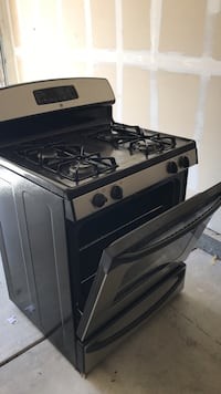 Black and gray gas range oven