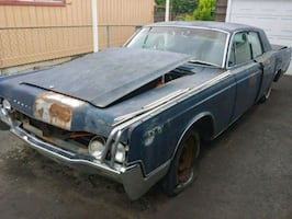 1967 Lincoln continental parts car. No engine. Floor is rusted.