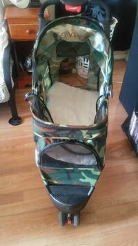 baby's green and brown camouflage jog stroller
