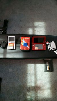 red Nintendo DS and silver Game Boy Advance Sp