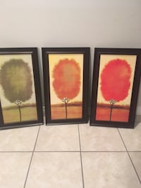 three orange, green, and red tree paintings with black frame CALGARY