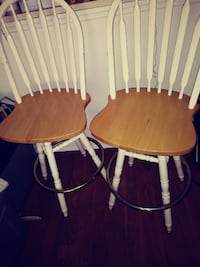 two brown-and-white wooden windsor chairs null