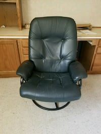 black leather office rolling armchair Grimes