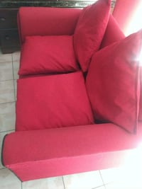 red fabric padded sofa chair