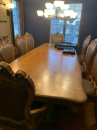 Formal Dining Room table with 2 leaves (pictured) and 8 chairs.