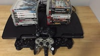 black Sony PS3 slim console with controllers and game cases Vancouver, V5S 3R1