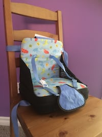 baby's white and blue bouncer Calgary, T3M 0J8