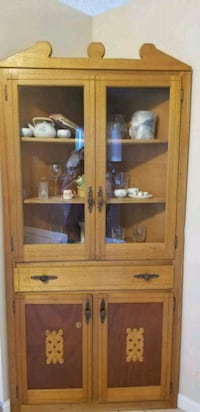 brown wooden framed glass display cabinet Colorado Springs, 80911