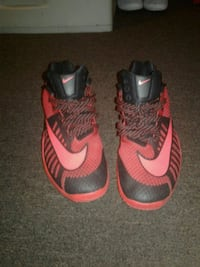 pair of red-and-black Nike basketball shoes Louisville, 40211