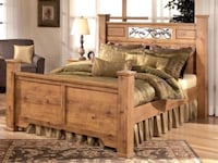 Brown wooden bed frame with white mattress Woodbridge, 22192