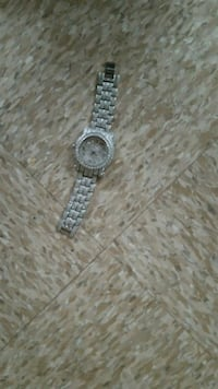 round silver analog watch with silver link bracelet Washington, 20009