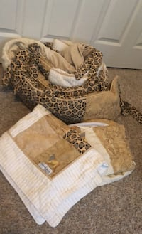 Baby bedding includes a crib skirt, blanket, and crib liner. Lion and tiger prints.  Fair Oaks, 95628