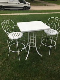 Steel table and chairs outdoors patio deck yard