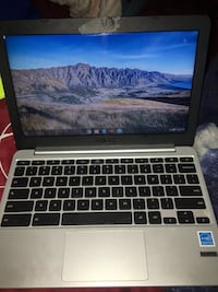 Black and gray laptop computer