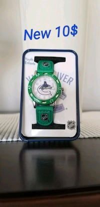 round white analog watch with green strap Brampton, L6R