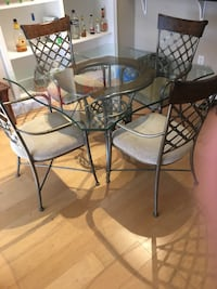 Glass kitchen table and four chairs. Pick up only.