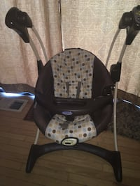 Baby's brown and white Graco highchair Silver Spring, 20902