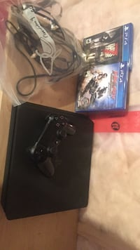 black Sony PS4 console with DualShock 4 with two game cases Smith-Ennismore-Lakefield, K0L